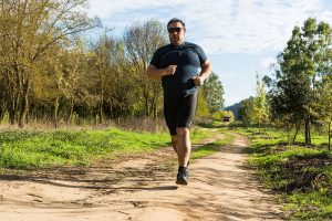 A man jogging on a trail