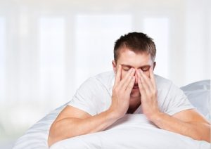 young man tired from lack of sleep