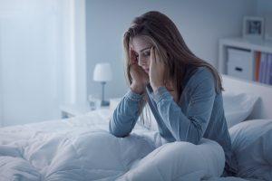 woman awake at night from insomnia